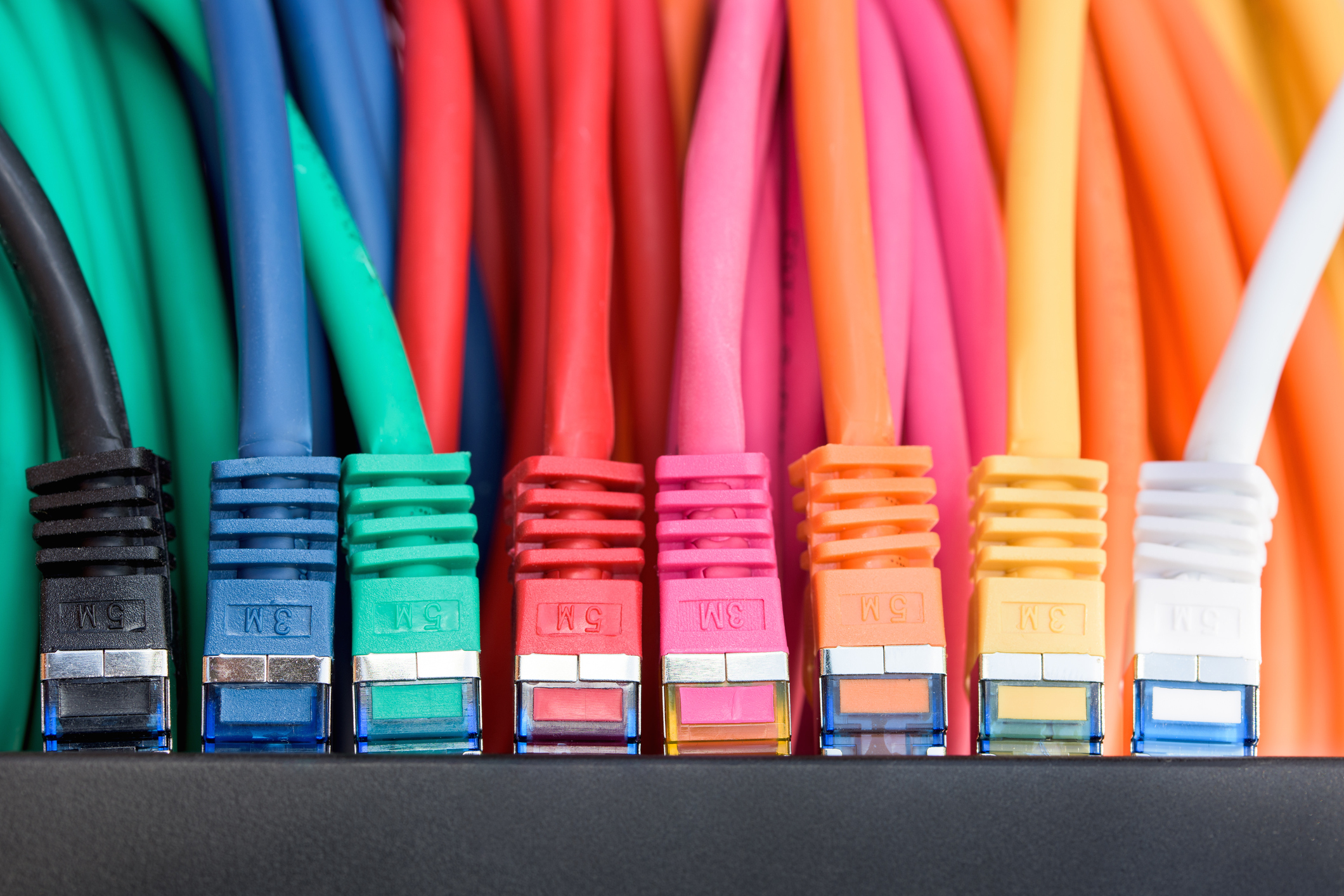 Colorful network cables connected to a switch
